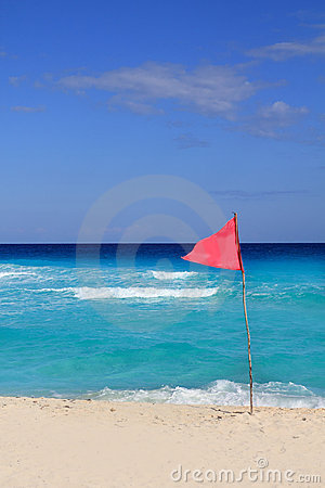 Dangerous red flag in beach rough sea signal