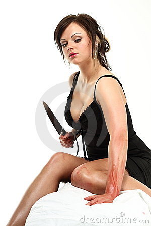 Woman with knife hands in blood