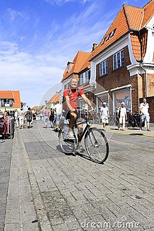 Danish man bicycling on street in Denmark Editorial Photo