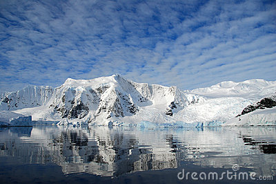 Dappled skies over antarctic mountain landscape