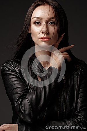 Free Daring Girl Model In Black Leather Dress, Style Of Rock, Dark Make Up And Beauty Hair. Stock Image - 125185781