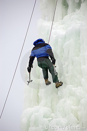 Daring Ice Climber on a Rope