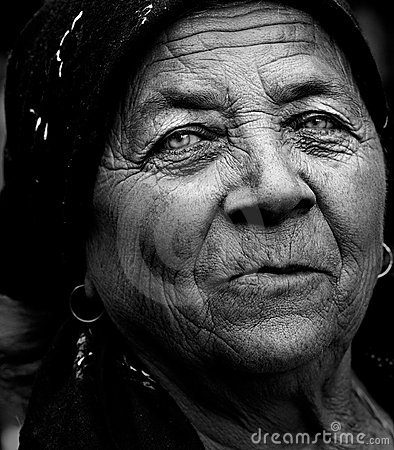 Dark artistic portrait of expressive senior woman