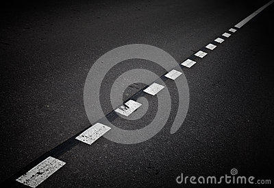 Dark asphalt road background with marking lines
