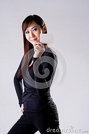 Dark blue girl with card