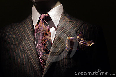 Dark brown striped jacket, purple tie and handkerc