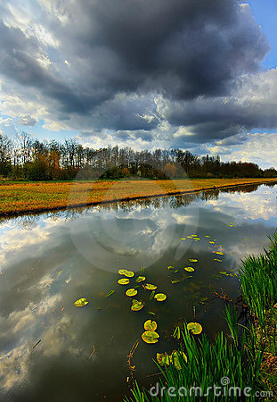 Free Dark Clouds Reflected In The Canal Royalty Free Stock Photos - 13438388
