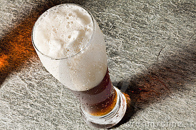 Dark cold beer with frothy