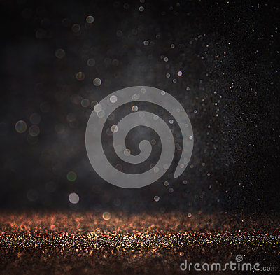 Dark glitter vintage lights background. light gold and black. defocused Stock Photo