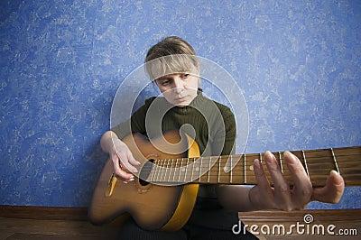 Dark grunge style rock star holding a guitar