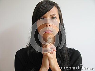 Dark hair girl praying