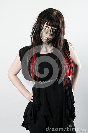 Dark hair with red tips on a girl with attitude