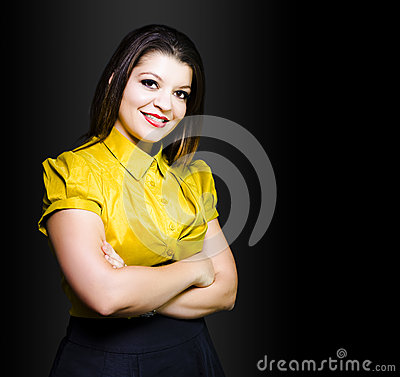 Dark haired business beauty in gold blouse