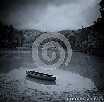 Dark Lake and Boat