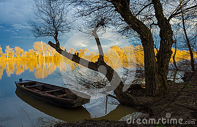 Wooden boat on the river in fall