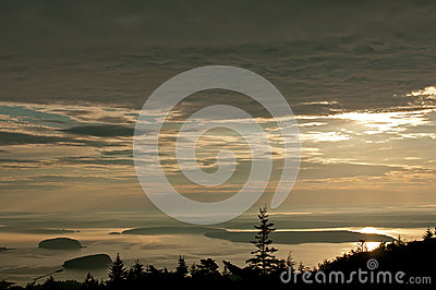 Dark landscape in sunrise with cloudy sky