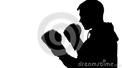 Dark male silhouette in hood attacking opponent, shadow-boxing self-defense Stock Photo