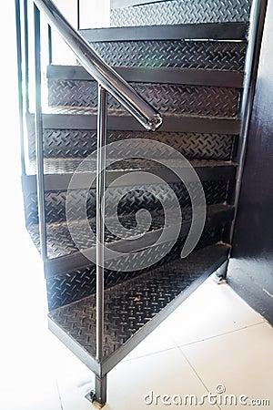 Dark metal modern spiral staircase