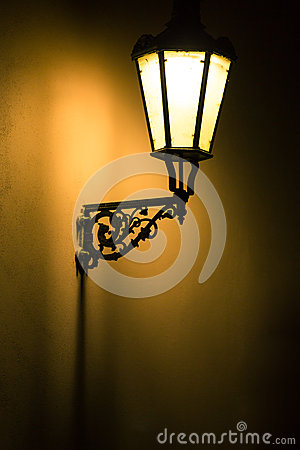Dark moody picture of old lamp on