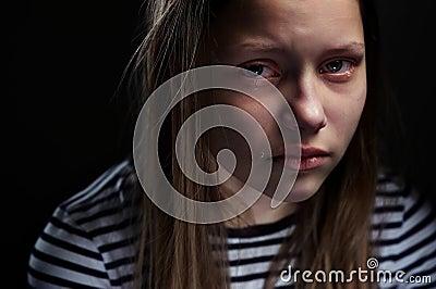 Dark portrait of a depressed teen girl