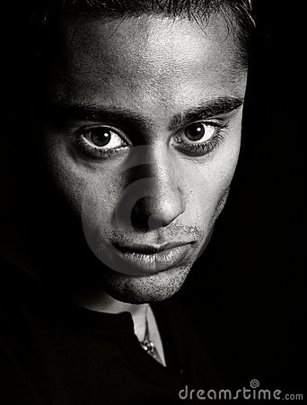 Dark portrait - face of one expressive man