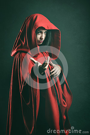 Free Dark Portrait Of A Beautiful Woman With Red Cloak Royalty Free Stock Image - 45204456