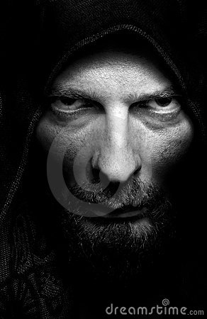 Dark portrait of scary evil sinister man