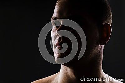 Dark portrait of strong athletic man