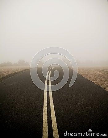 Dark Road in Fog
