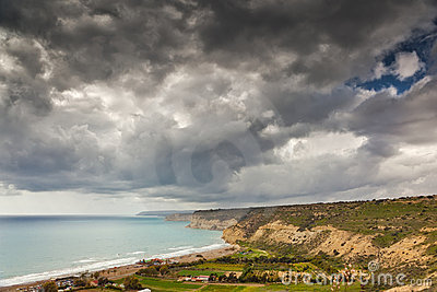 Dark sky over coastline