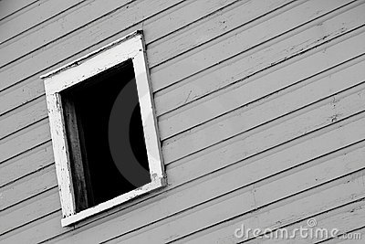 A Dark Window In A Gray Wall