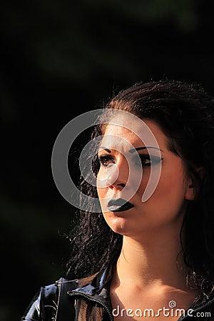 Dark woman with dark make-up