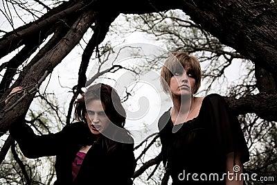 Dark women in a forest