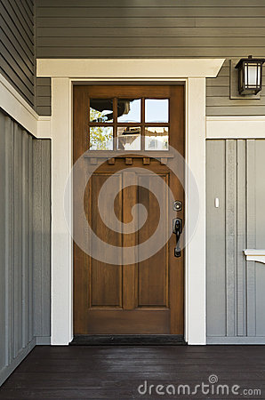 Dark wood front door of a home