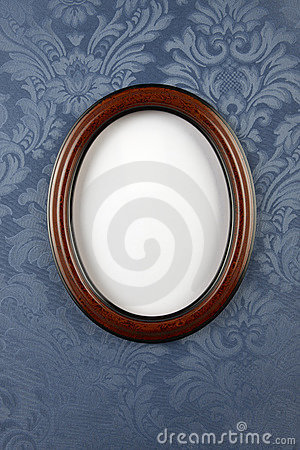 Dark wood oval wall frame