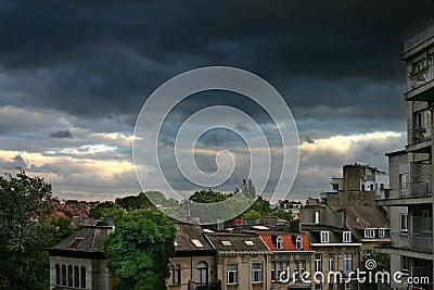 Heavy rain clouds over city