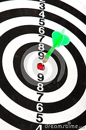Dart in bullseye of dartboard