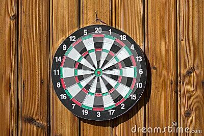 Dartboard on wood wall (no darts)