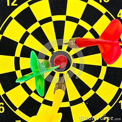 Darts miss the target.