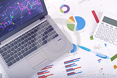 Data analysis - workplace with business graphs and charts, laptop and calculator Stock Photo