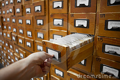 Database cabinet and human hand opens card drawer