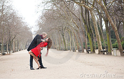 Dating couple dancing in a Parisian park