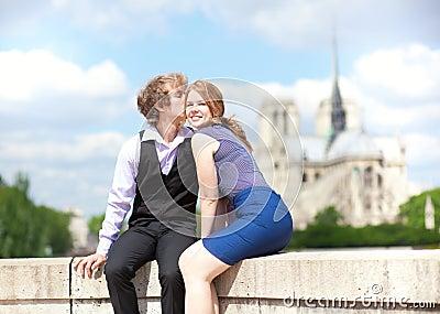 Dating couple enjoying warm day in Paris