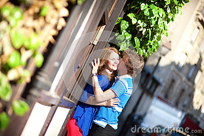 Dating couple kissing on Montmartre