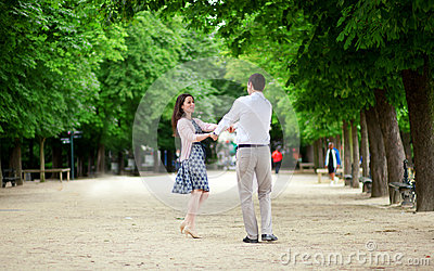 Dating couple in Luxembourg garden