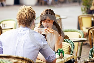 Dating Couple Together in a Parisian Street Cafe