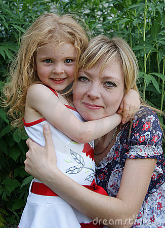 Daughter embraces mother in the park