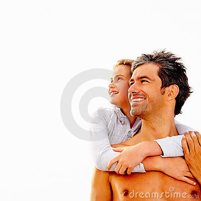 Daughter embracing her father from behind