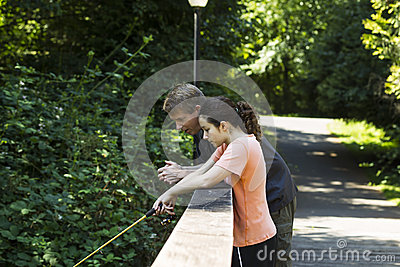 Daughter and Father Fishing together