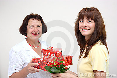 A daughter giving her mother presents